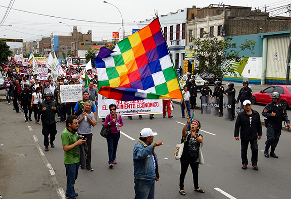 People march in Lima, Peru.